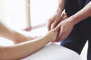 Woman's foot massage at the spa, relaxation rest. photo