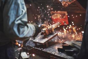 Industrial factory weld worker. Welding or welder master weld the steel photo