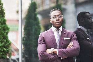 A beautiful young African American who thinks about a serious idea. Confident in making business decisions. photo