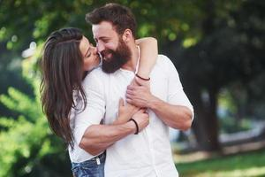 Romantic couple enyojing in moments of happiness in the park. Lifestyle concept love and tenderness photo