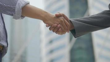 Asian businessman shaking hands. video