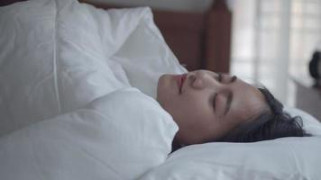 Young Asian women sleeping well comfortably in the bedroom at home. video