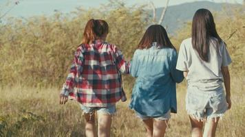 Three young Asian women running having fun together a summer traveling. video