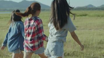 Group of young Asian women running having fun together a summer traveling. video