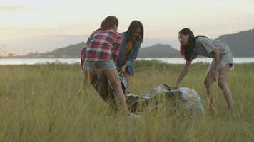 Asian women camping pitch a tent enjoying having fun together a summer traveling. video