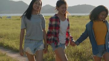 Asian women running while sunset having fun together a summer traveling. video