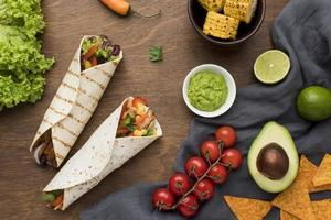 top view delicious mexican food with guacamole photo