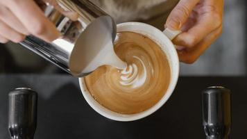 top view male barista pouring milk coffee cups photo