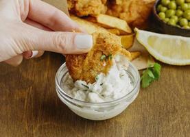 woman dipping fish sauce photo