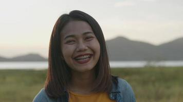 Portrait of beautiful young Asian woman smiling look at camera. video