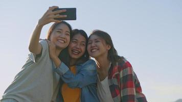 Group of a young Asian woman taking selfies having fun together a summer traveling. video