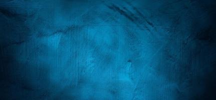 Blue wall background. The dark blue walls are scary. Scratched blue cement photo