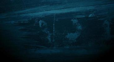 Scratches on dark blue cement for background photo