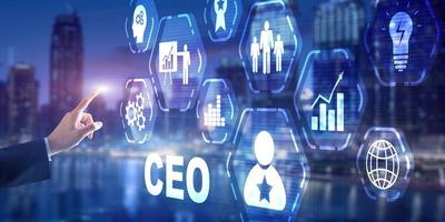 Chief Executive Officer CEO concept. Businessman hand touching CEO on virtual screen photo