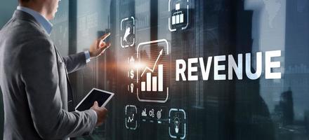 Revenue. Raising income concept. The businessman plans to increase his revenue photo