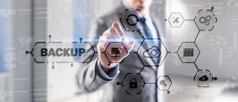 Backup Storage Data Technology concept. Businessman touching Backup photo