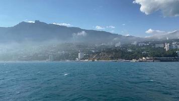 The flight of a seagull over the sea along the coastline of Yalta, Crimea video