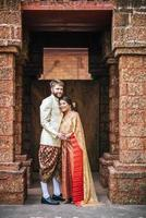 Asian bride and Caucasian groom have romantic time with Thailand dress photo