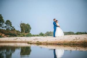 Asian bride and Caucasian groom have romance time and happy together photo