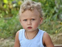 Beautiful baby boy with child face posing photographer for color photo