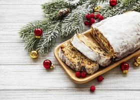 Christmas stollen on wooden background photo