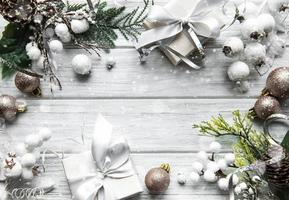 Christmas or winter composition. Frame made of  decorations on white wooden background. photo