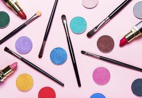Makeup brushes and eye shadows photo