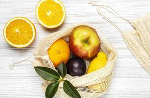 Mesh shopping bag with fruits photo