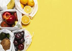 Eco shopping bags with fruits photo