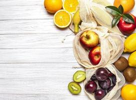 Mesh shopping bags with fruits photo