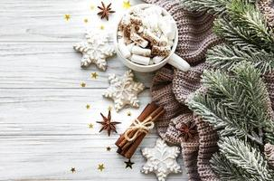 Christmas composition with cup of hot chocolate and decorations photo