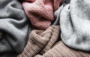 Background with warm sweaters. photo