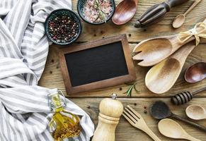 Empty chalk board and kitchen utensils photo