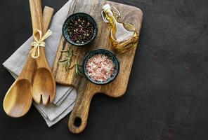 Old wooden kitchen utensils and spices photo