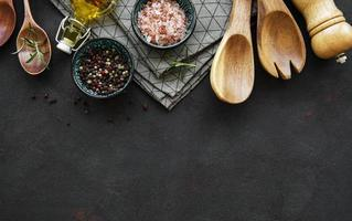 Old wooden kitchen utensils and spices as a border photo