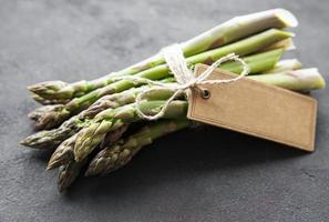 Fresh green asparagus with empty tag photo