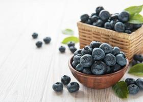 Blueberries on old wooden background photo