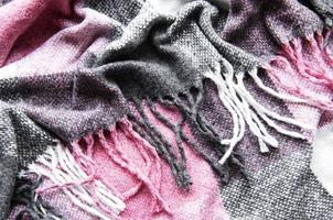 Crumpled warm woven pink and gray plaid photo