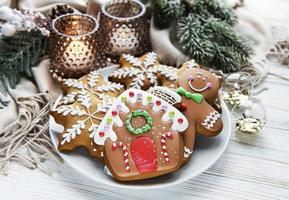 Christmas gingerbread in the plate on white. Top view. photo