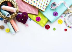 Sewing accessories on a white background photo
