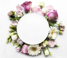 Pink flowers in round frame with white circle for text photo