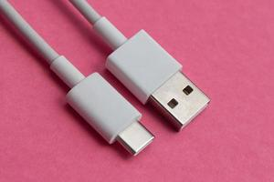 USB cable type C over pink background photo