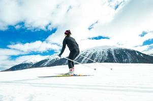 A young woman practicing Nordic skiing photo