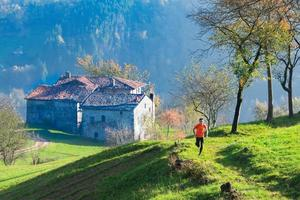 Old hamlet of Italian wings with mountain runner photo