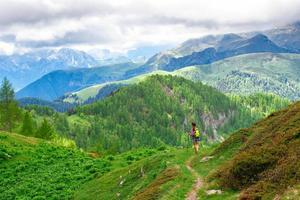 Of mountain landscape with path and girl walking photo