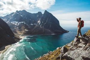 Man stand on cliff edge alone enjoying aerial view photo