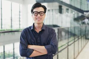 Portrait of an Asian business man, confident and smiling photo