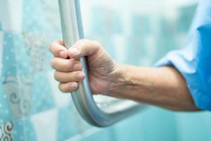 Asian senior patient use handle security with help support photo