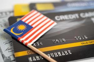Malaysia flag on credit card. Finance development, Banking Account, Statistics, Investment Analytic research data economy, Stock exchange trading, Business company concept. photo