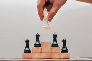image of chess pieces on a chessboard photo